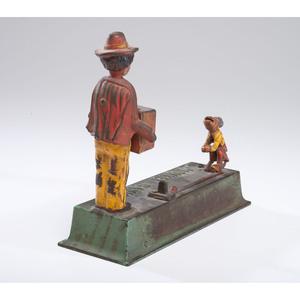 A Cast Iron Mechanical Monkey Bank