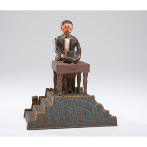 A Cast Iron Mechanical Magician Bank