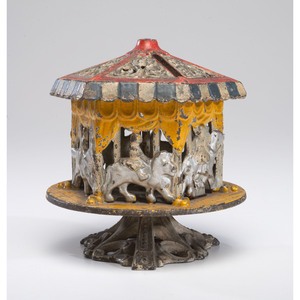 A Carousel Cast Iron Revolving Bank
