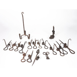 A Group of Cast Iron Candle Holders and Accessories
