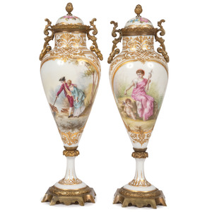 A Pair of Sevres-style Lidded Urns in White and Gilt