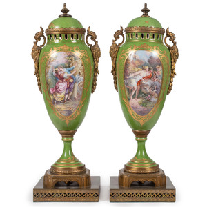 A Pair of Porcelain Urns in Green with Ormolu Mounts