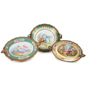 Three Sevres-style Gilt and Polychrome Plates with Ormolu Stands