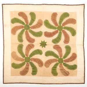An Appliqué Feather Pinwheel Quilt