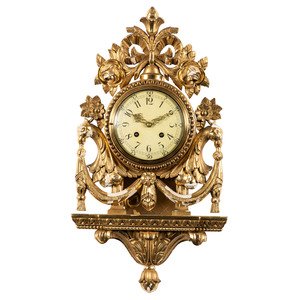A Giltwood Cartel Clock