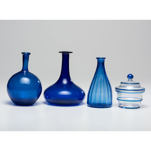 A Group of Blown Cobalt Glass Bottles and Jar