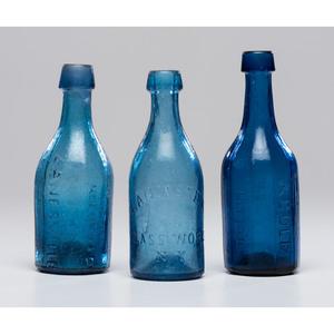 Three Cobalt Glass Soda Bottles Including a Rare Zanesville Example