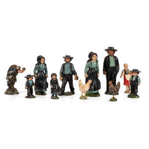 Eleven Toy Figurines, Including Seven Cast Iron Amish Figures