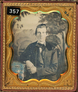 PAIR OF DAGUERREOTYPES WITH PAINTED BACKDROPS