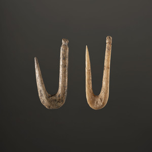 A Pair of Bone Fish Hooks, Largest 1 in.