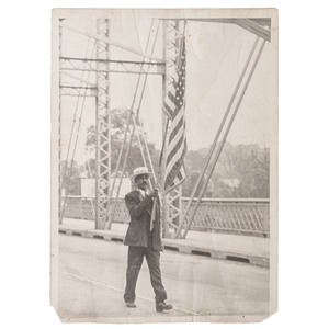 [AFRICAN AMERICANA]. Outdoor photograph of African American man holding an American flag. N.p., n.d.