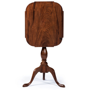 A Federal Figured and Carved Walnut Tilt-Top Candlestand with Shaped Top, Mid-Atlantic States, Circa 1790