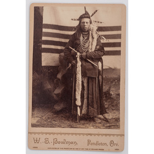 [PHOTOGRAPHY - NATIVE AMERICAN]. Cabinet Card of Nez Perce Brave. Pendleton, OR: W.S. Bowman, [ca 1885-1891].