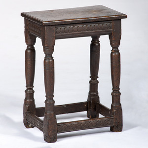 A Diminutive Carved Oak Stand