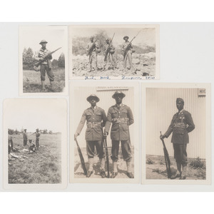 [WORLD WAR II]. A group of 5 photographs of African American soldiers, comprising: