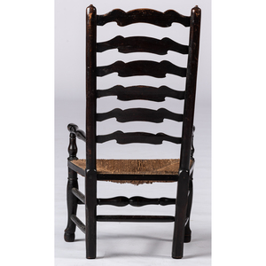 A William and Mary Black-Stained Ladder Back Rush-Seat Armchair