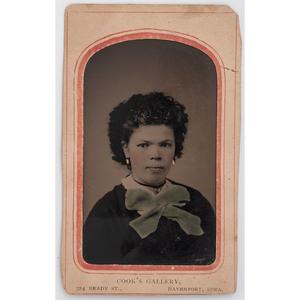 [TINTYPE - PORTRAITURE]. COOK'S GALLERY, photographer. Tintype of young African American woman. Davenport, IA: [ca 1870s].