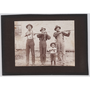 [AFRICAN AMERICANA] -- [EARLY PHOTOGRAPHY]. Photograph of four armed African American subjects. N.p., [ca early 20th century].