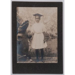 [AFRICAN AMERICANA] -- [EARLY PHOTOGRAPHY]. Photograph of African American girl with alligator. N.p., [ca early 20th century].