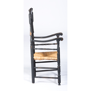 A William and Mary Black Painted 'Heart and Crown' Bannister Back Rush-Seat Armchair, Likely Milford, Connecticut, Circa 1760