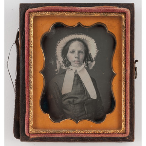 [DAGUERREOTYPE - PORTRAITURE]. Ninth plate daguerreotype of a possible Creole woman wearing a hat. N.p., n.d.