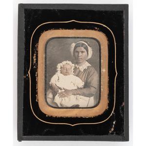 [DAGUERREOTYPE - PORTRAITURE]. Sixth plate daguerreotype of a mixed race woman holding a sleeping infant. N.p., n.d.
