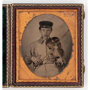 [AMBROTYPE - PORTRAITURE]. BARNARD, photographer. Sixth plate ruby ambrotype of soldier with fiddle. N.p., n.d.