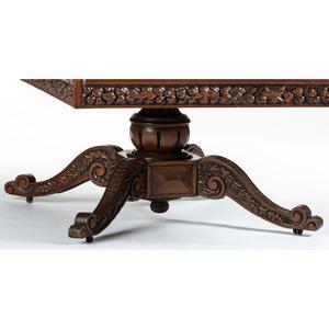 A Cincinnati Art-Carved Dining Table in Walnut, Late 19th Century