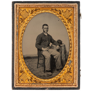 [CIVIL WAR]. Quarter plate ambrotype of Union infantry private seated in a studio. N.p.: n.p., [ca 1861-1862].