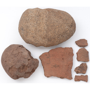 A Double Grooved Axe, Hammerstone, and Pottery Shards