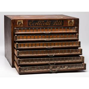 A Corticelli Silk Stenciled Tabletop Spool Cabinet