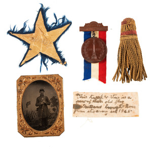 [CIVIL WAR]. A group of 12 items belonging to Corporal Willard Norton, 122nd New York Infantry, incl. quarter plate tintype, star and tassel from Civil War flag, and Gettysburg veteran medals.
